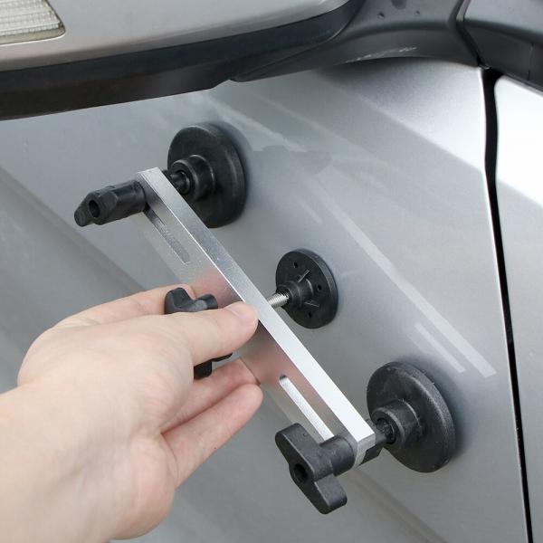 Automobilio kėbulo įlenkimų šalinimo įrankis